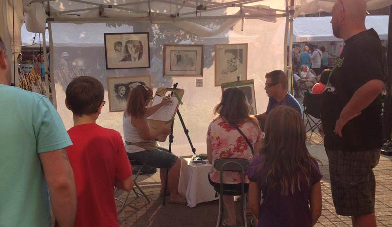 Caricautre artist gather a crowd at Collingwood Elvis Fest