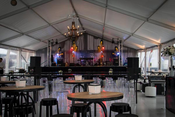 The stage and room in the tent at Nick and Nicole Moss's Wedding