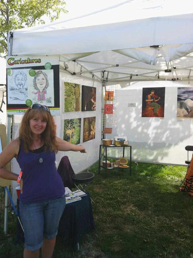 Artist in her outdoor booth